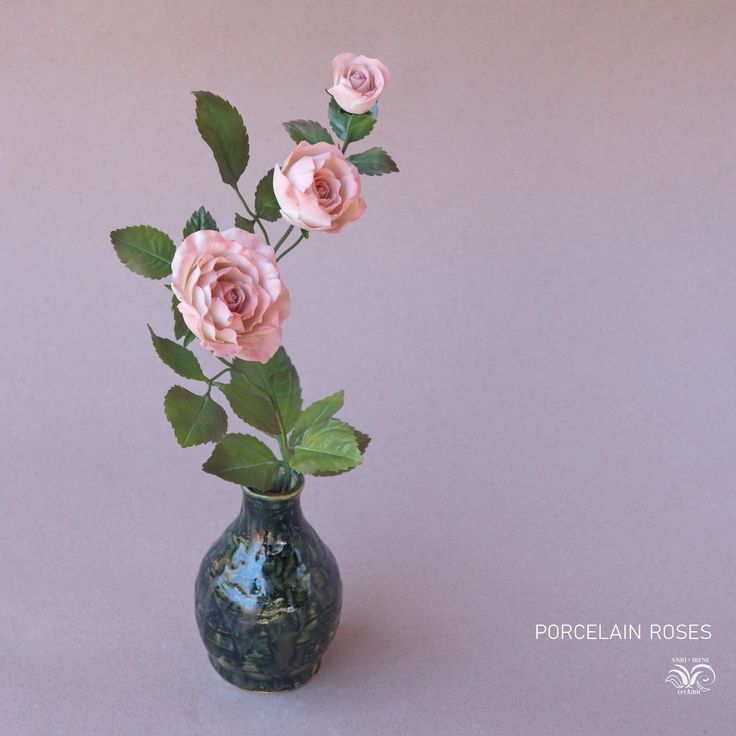Porcelain roses. Painted copper leaves and stem. Ceramic vase handmade too. The combination of…»