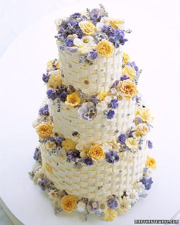 Crystallized Flower Wedding Cake    Buttercream baskets brim with crystallized flowers, including pansies, roses, lavender, cornflowers, and violets. Sugaring flowers gives them a sparkling appearance; if you want guests to be able to nibble on these lovely decorations, be sure to acquire them from a reputable supplier.