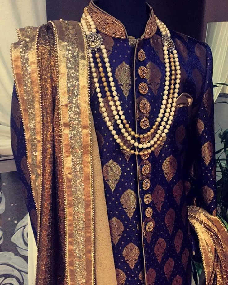 """""""Our new men's collection is so regal. We paired this beautiful piece up with one of our popular shawls. All shawls are available for pre-order online at…"""""""