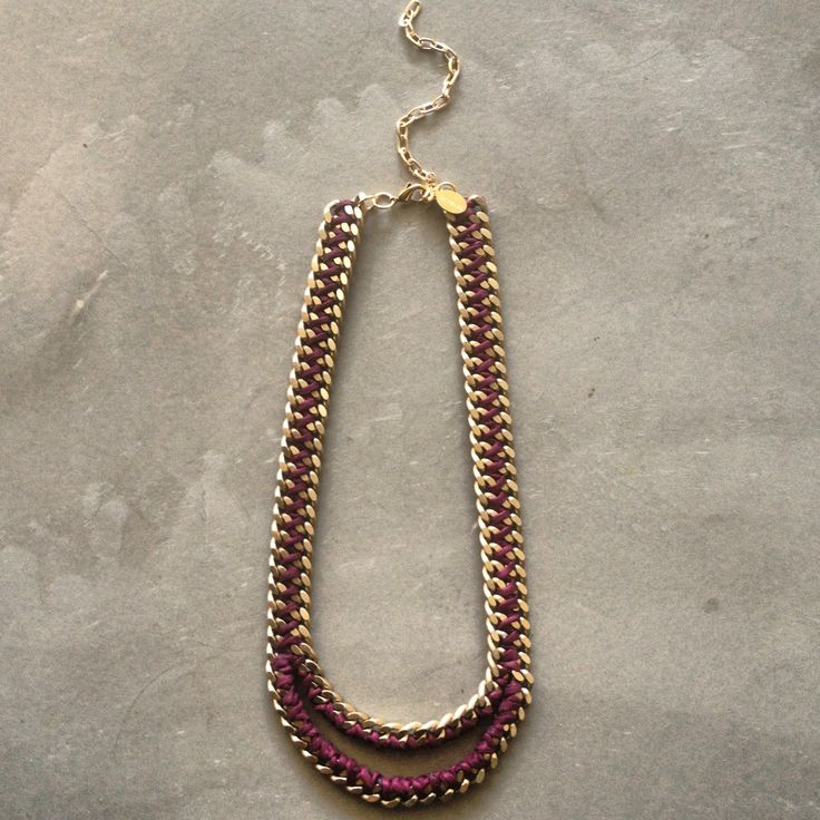 The Mouth necklace in burgundy and matte gold chain by Hermina wristwear and more