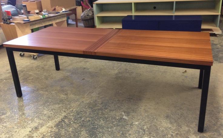 CUSTOM NEVINS TABLE Black Metal Base And Ribbon Striped Sapele Veneer Table  Top With Cross Grain