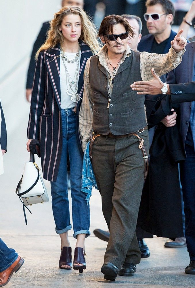 Amber Heard with Johnny Depp in a white t-shirt and Levi 501 jeans and a pinstripe coat