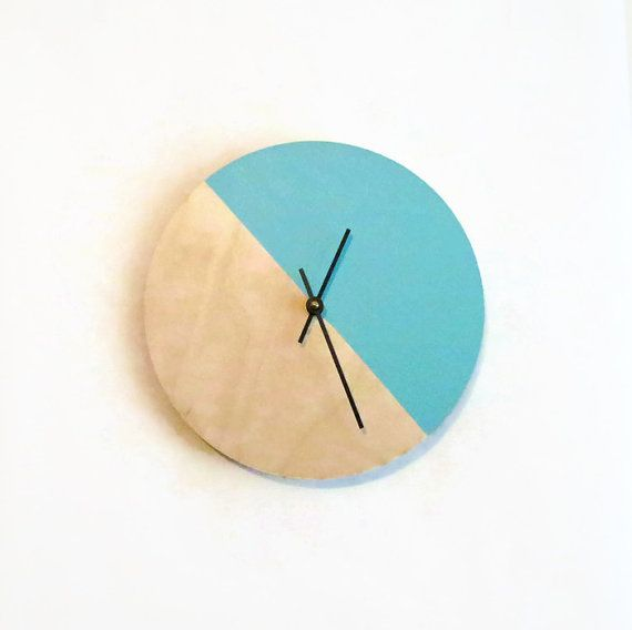 This modern wall clock will add a clean, crisp touch to your home decor. The baltic birch wood base is hand painted leaving half of the face the natural wood and half light aqua or Ocean Green. This beautiful clock has a touch of modern chic flair that will quickly become a focal point in your space. This wall clock is a Shannybeebo original design. Order now!  This clock can be made in larger sizes and any color combination that you would like. Please contact me with special color or size…