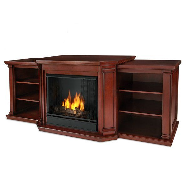 """Add a whole new look to your home decor with this Valmont 75.5"""" TV Stand with Fireplace. It sports a traditionally styled frame with angles columns, flared corbels and recessed side panels. The dual functionality offered by the stand makes it a superb addition to any home-space. The flat tabletop of the stand is wide enough to accommodate flat panel TV of any size weighing up to 100 lbs. Two open shelves are provided on either side, where you can store your cable box or media player. The..."""