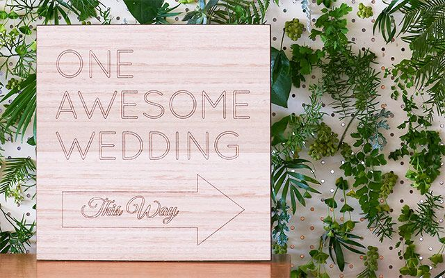 'One awesome wedding this way' sign.