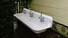 This Antique Cast Iron Farm Sink With Faucets & Brackets. Original Dazzling Porcelain. Standard American Trough Industrial Gang. EXCELLENT CONDITION. 5 feet long by 17 inches deep front to back. Porcelain is in amazing original condition. Sink is being sold with the faucets and