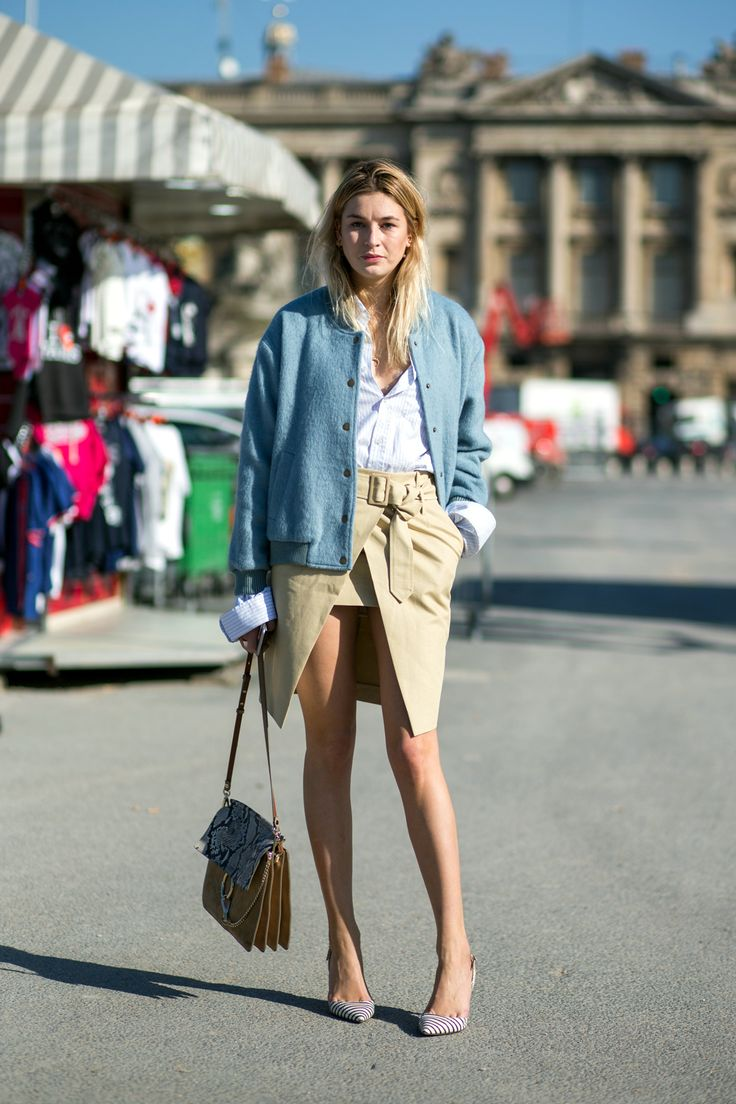 """Try Out The Khaki Comeback With A Not So Girly """"Little Tan Skirt"""" #refinery29  http://www.refinery29.com/khaki-skirt-outfits#slide-2  Balance out a front-slit skirt with an oversized denim jacket and some extra long sleeves — playing with proportions like a pro...."""