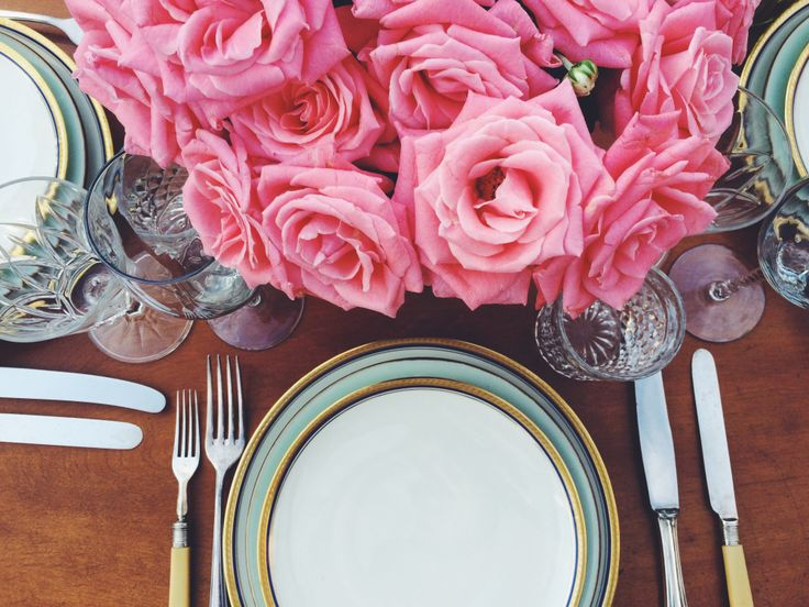Pink roses bouquet, vintage cutlery. Romantic tabletop. Vintage, Bavaria porcelain plates and cristal glasses. Outdoor dinner.