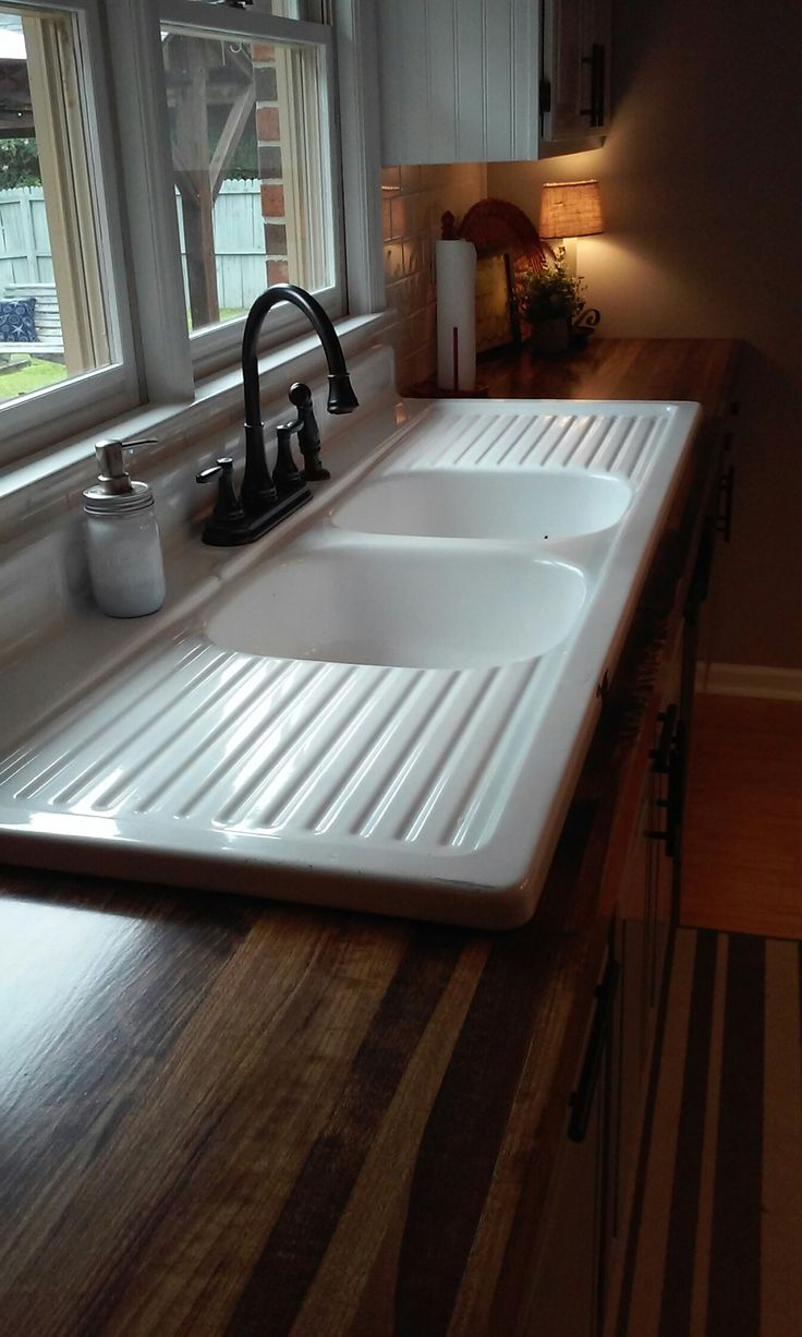 Finished our wooden countertops and installed our 65 yr. old farmhouse drainboard sink. More pictures of our remodeled kitchen under my board Homemade Happiness.