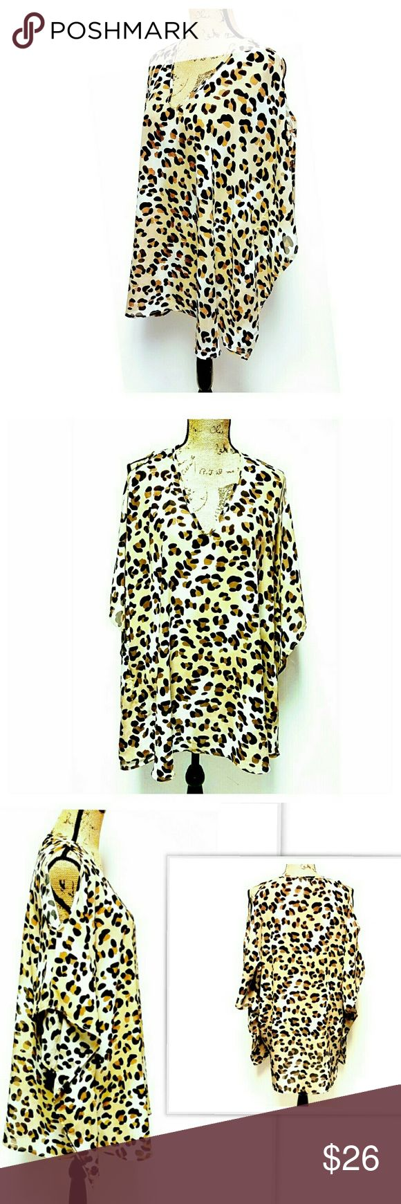 "Leopard Print Top by Let Them Eat Cake Super cute cold shoulder leopard print tunic by Let Them Eat Cake. Size S. Excellent pre-owned condition. Approximate measurements laying flat: length 30"", bust 27.5"". Let them Eat Cake Tops Tunics"