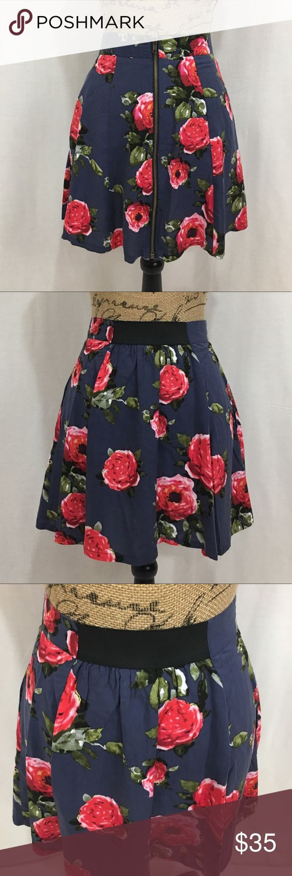 """UO pins and needles rose floral zip up skirt Super cute. NWOT. Never worn. Fully zip up front. Stretchy band section in back. size small. Pins and needles is sold by urban outfitters I purchased this there. Pockets. 100% viscose. Navy blue with roses/floral. Green& red/pink colors too measurements are approx in inches laying flat. W-13 H-23 length-16.5 small fabric flaw """"line"""" seen pic 8   🌹no trades 🌹discounts on bundles of 2+  🌹1000 items listed, take a peak!  🌹suggested user, posh…"""