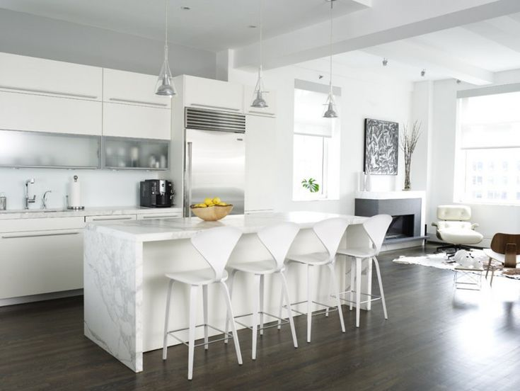 kitchen white wall white ceiling white furniture dining chair modern lights countertop metal faucet of White Kitchen Designs to Get Inspirations From
