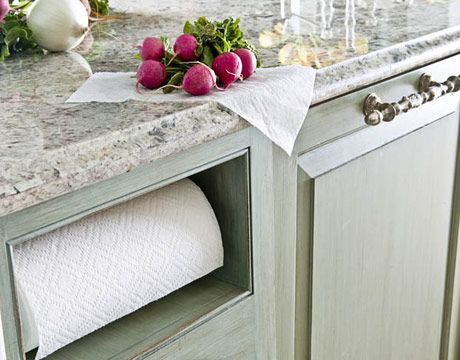 Paper Towel Niche  A niche keeps the paper towels accessible, yet out of sight. The Bianco Tuscano granite countertop is finished with an ogee edge, to soften the hard surface.