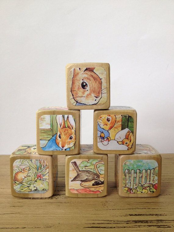 This set of 6 Storybook Blocks features images from the classic childrens book, The Tale of Peter Rabbit. This is a made-to-order set, and personalization is welcome! Please convo me to discuss. Illustrations may not match the above set exactly/be placed in the exact order, but will contain a generous sampling of the beautiful illustrations from the book! :-)  Storybook Blocks present beautiful and familiar images to babies and toddlers in an engaging way. Let their favorite stories come to…