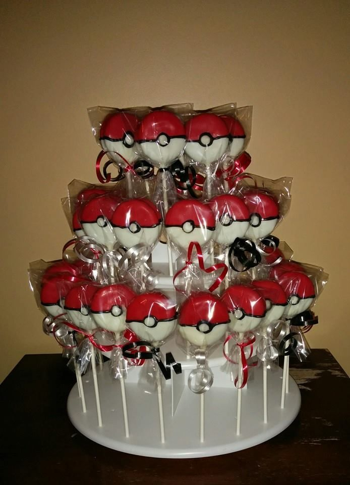 Pokemon balls made from Oreos and wrapped in cellophane bags and tied with ribbon.