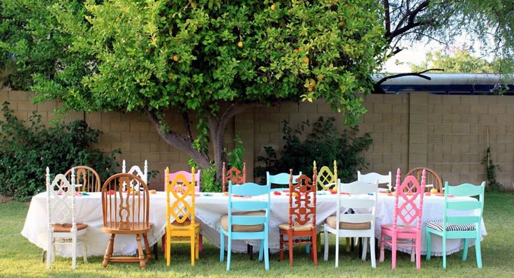 mixing up chairs is a really cute idea for an outside party, if you don't have any you can always look at a local resale or goodwill, some spray paint and a pretty fabric for a seat cushion will make it dreamy!