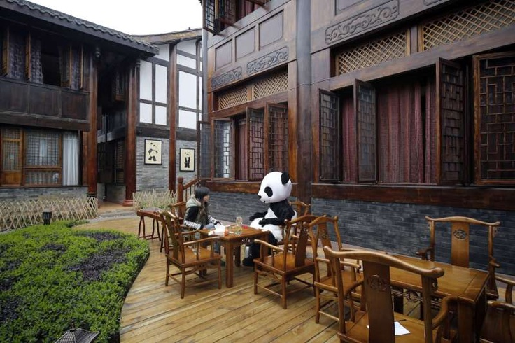 """‪The world's first panda-themed hotel will open at the foot of Emei Mountain, Southwest China's Sichuan province. ‬The hotel will officially open in May with room rates from 300 to 500 yuan ($48 to $80) per night.‬"""