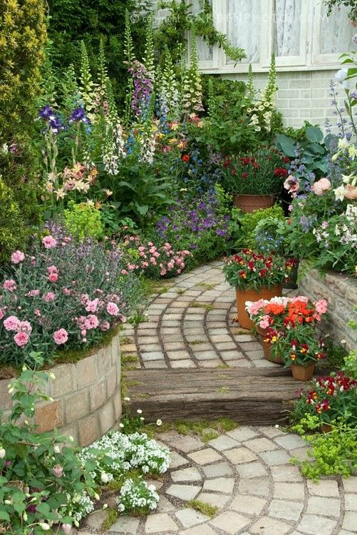 cottage garden path  Note the tall dianthus in the foreground. May match well with lavender due to similar color foliage but contrasting flowers.