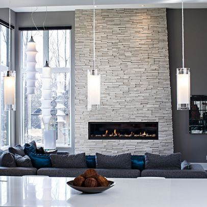 white stone fireplace grey walls, except one that doesn't go all the way up  to the ceiling, maybe black mantle