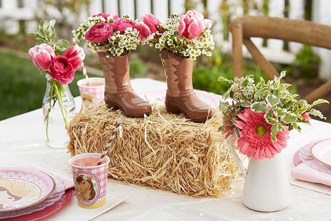 Pink cowgirl party table centerpiece