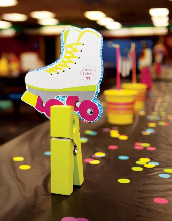 Neon Roller Skate Party neon confetti, healthy snacks (of course sweet treats too!) & printable decoration to transform the picnic style tables at the rink!