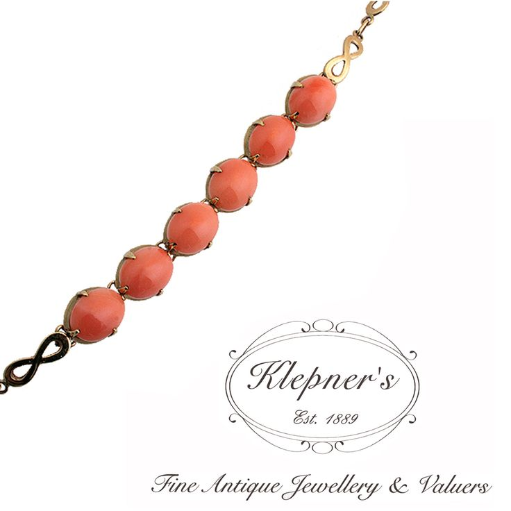 9ct yellow gold vintage coral bracelet, claw set with six coral cabochons & finished with an infinity link chain. Visit us at www.klepners.com.au