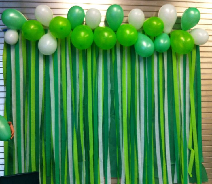 This is something I did for our School Spirit Dance! REALLY easy. It's streamers taped in a line with butcher paper underneath and balloons to cover the tape! SO easy!