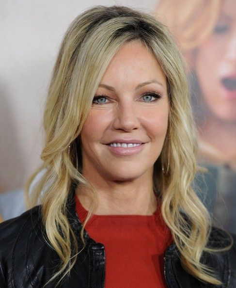 Heather Locklear's Long Hairstyle: Heather Locklear stays true to her signature blonde look with bright highlighted tresses. The actress opts for long, loose waves to keep her red carpet look glamorous.