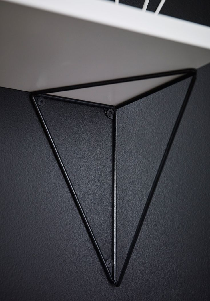 the shelf system by maze interior takes form depending where the brackets are placed; in the same way as a triangle's sides are based on two points.