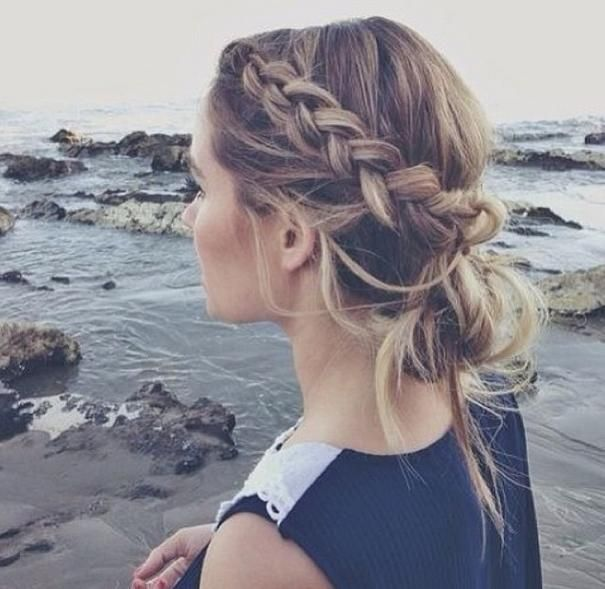 Gorgeous braid and messy bun. Perfect for the beach.