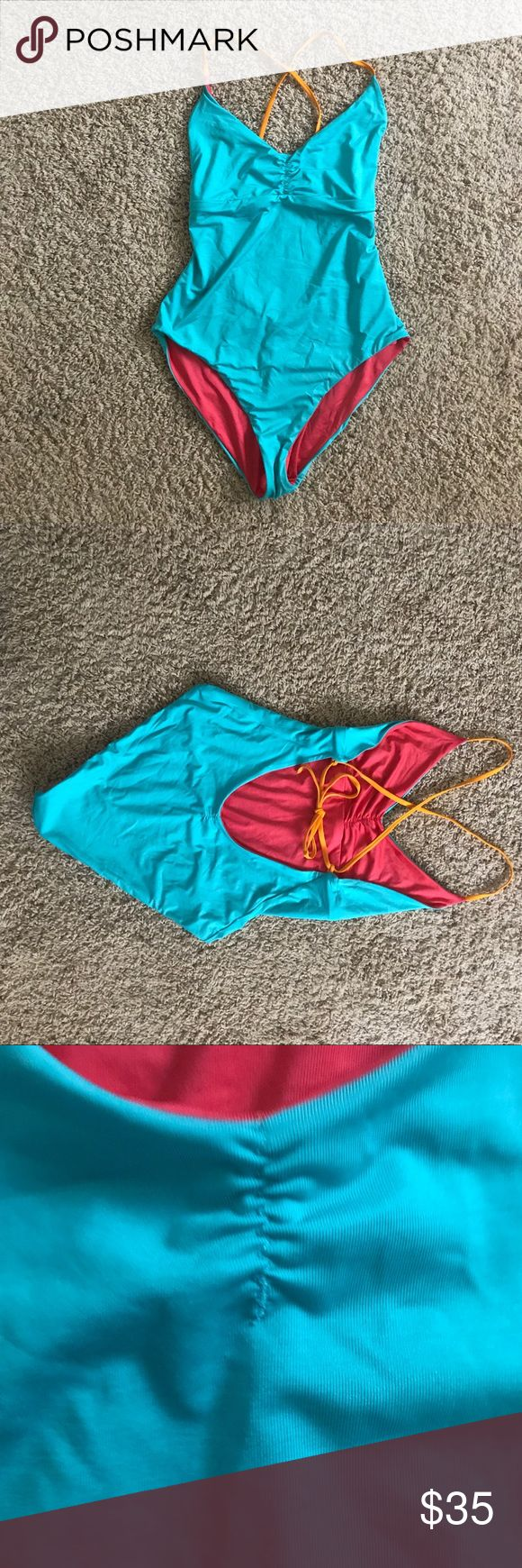 Patagonia one piece bathing suit, reversible! Lovely teal or pink bathing suit form Patagonia 2 bathing suits in 1! From last summer. This was one of those aspirational purchases but my butt will just never fit in this. Reversible and with yellow accent for the halter. There is a little extra thread you can see in two of the photos but it does effect the integrity of the garment; you can snip them off once this suit is yours! Last pic is not mine but is the style name from Patagonias…