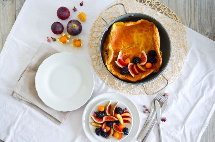 Turmeric Dutch baby pancake with vanilla, cinnamon, ginger, rose water and fresh figs, plums, blackberries and physalis