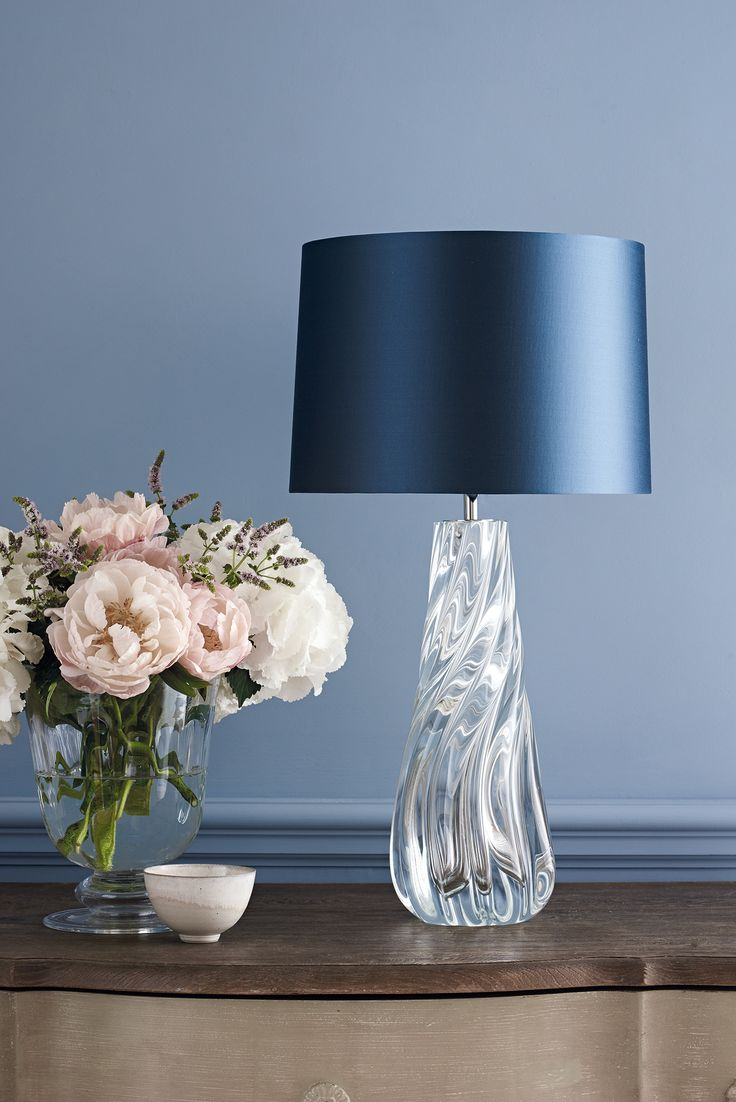 NAIAD GLASS  The Naiad lamp is a naturally formed hand blown piece, in melted clear crisp glass. The generous fluidity, and curves give this lamp a true artisan feel. This design is individually crafted and will vary from piece to piece.