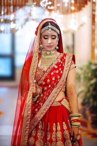 Indian Wedding Jewelry - Bridal Portrait of a bride Wearing a Matha Patti and a Choker Square Necklace | WedMeGood #wedmegood #indianbride #indianwedding #lehenga #bridal #red #lehenga #indianjewelry #jewelry