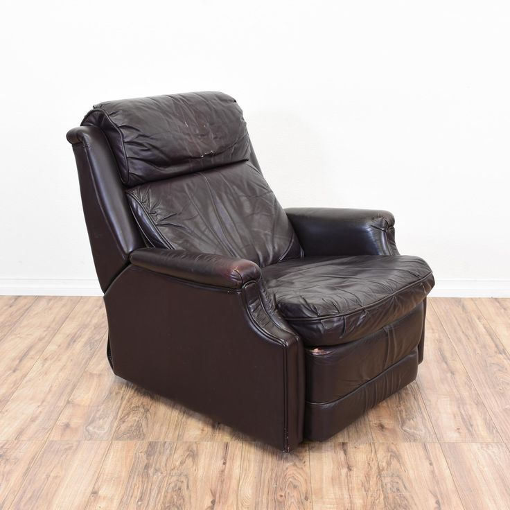 """This """"Barcalounger"""" recliner is upholstered in a durable shiny dark brown leather upholstery. This armchair is in great condition with a reclining back, a lift up foot rest and comfortable cushions. Perfect for lounging and napping! #traditional #chairs #recliner #sandiegovintage #vintagefurniture"""