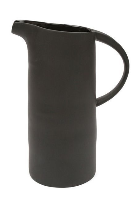 """michele varian black porcelain pitcher http://www.refinery29.com/cool-gifts#slide-6 """"My mother is not only the best cook I know — no, seriously, Ella's nailed everything from pancakes to homemade Korean fare — but also the best hostess. Especially in the summer, she loves to have large indoor/outdoor dinner parties and goes wild making it all happen. One of her biggest pet peeves, though, is setting a nice table and having a big water bottle on it. Problem is, our water glasses are small…"""