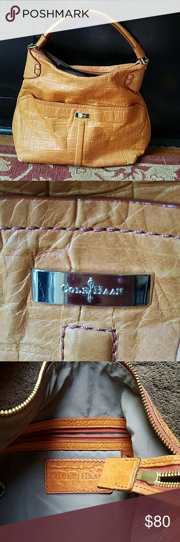 Cole Haan Tan Leather Shoulder Purse Slightly orange/tan leather purse with texture. Has two large pockets on outside and three pockets on inside. Has a few marks but still in very good shape. Cole Haan Bags Shoulder Bags
