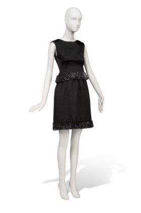 CHARADE, 1963  A COCKTAIL GOWN OF BLACK SATIN