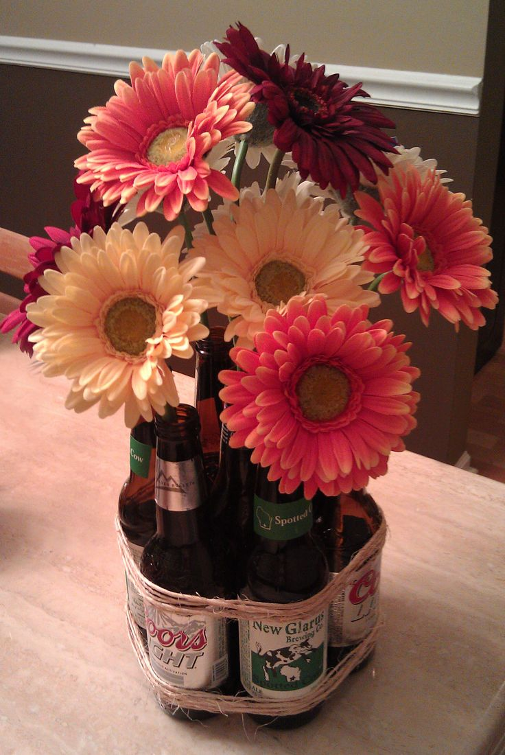 Beer Bottle Flower Vase. Designed and created by QBcheck Designs. https://www.facebook.com/Qbcheck.Wedding.Stationary