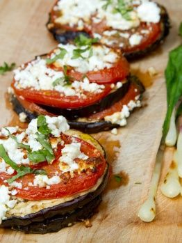 Eggplant, tomato, basil and feta cheese… Salt eggplant, let sit for 30min, pat dry, grill in skillet a few minutes each side. Place in lightly oiled baking sheet, top with evoo/garlic/basil/feta, top with tomato slice, top with more garlic/evoo/basil/feta, and bake at 400F for 15 minutes.