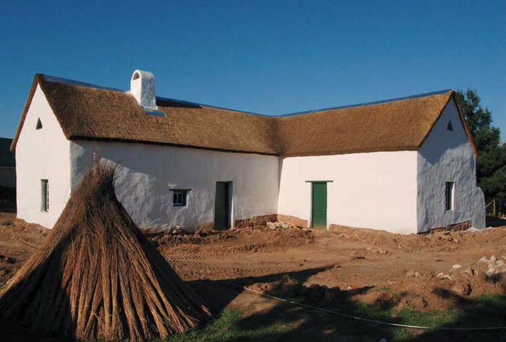 Fourie House in June 2007, with its new thatched roof and lime-washed walls. The front of the house faces away to the right