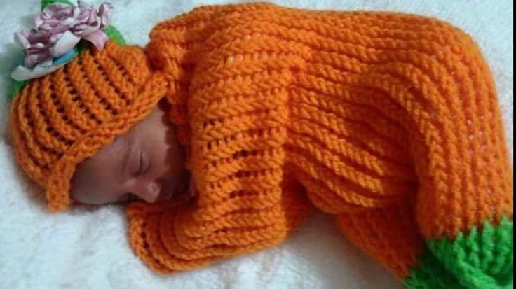 My rainbow baby in her pumpkin sleep sack made by mommy