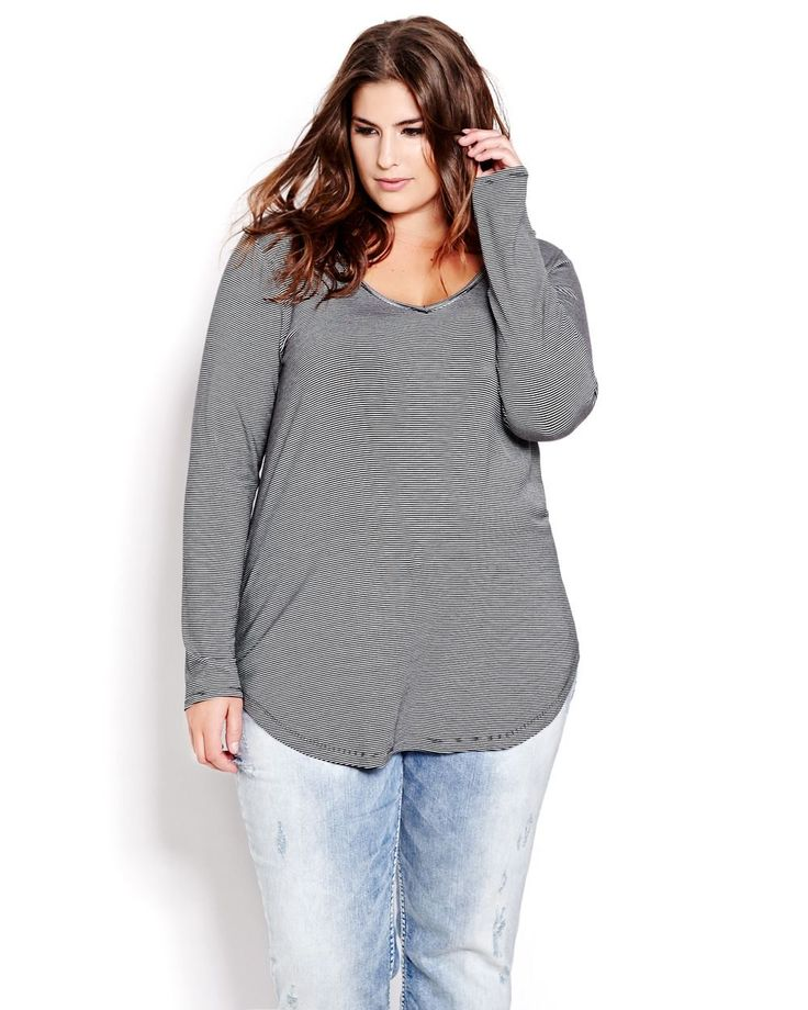 Super soft and stretchy long sleeve tee with feminine rounded V neck and flattering A line shape elevates the art of the basic t-shirt. Plus size, long sleeves, rounded shirt tail hemline. 30 inch length. Perfect for layering!