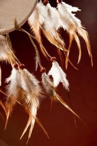 DREAM CATCHER. Supplies needed: wire coat hanger, string, ribbon or rawhide, sinew or thread, beads and feathers.
