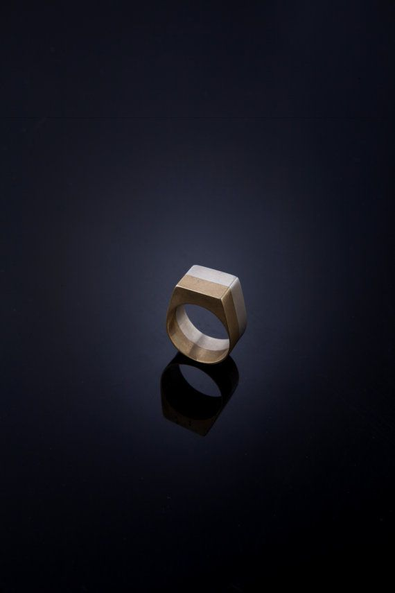 This Beautiful unisex Double colored Signet Ring made from Sterling Silver and Brass. it is squre and has a very nice impact on the hand  size:6.5