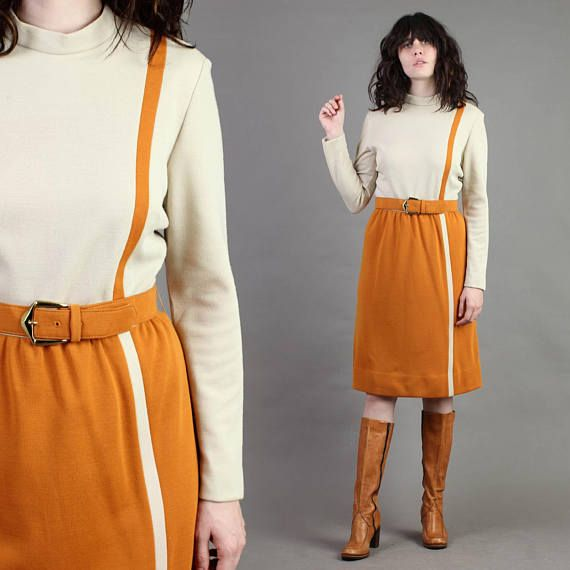 DESCRIPTION Beautiful 1960s dress! Quality made by I.Magnin & Co. Total Mad Men vibes. Thick wool knit blend. Color block pattern in cream and burnt orange colors. Long sleeves. Fitted waistline. Midi length skirt. Matching buckled belt in burnt orange. CONDITION Excellent vintage