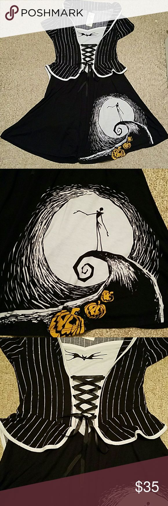 """Nightmare Before Christmas Dress from Torrid This is a very cute and soft dress. A line. Nipped at waist. Ribbon tie in front. Short sleeves. Flip up or down collar. Never worn. Hits just  above the knee and I am 5'4""""  This is a plus size. Equivalent to size 10 Torrid Dresses Midi"""
