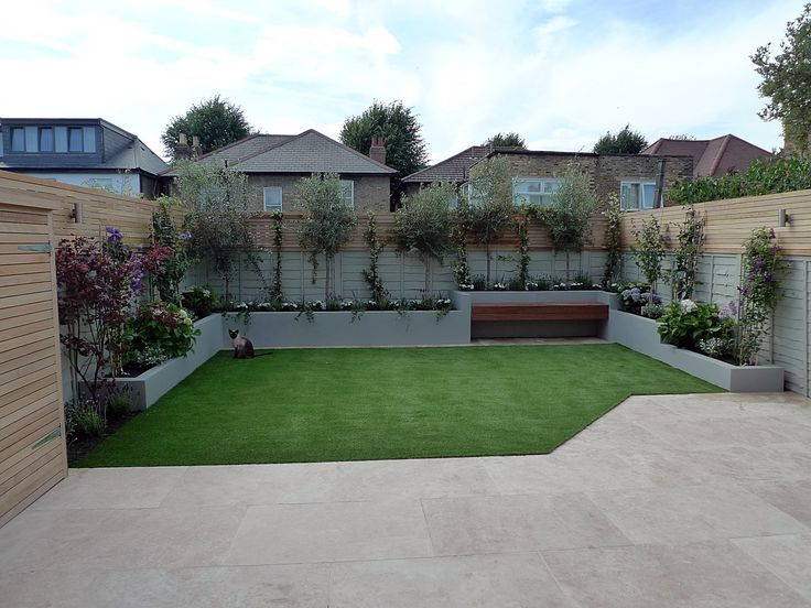 small garden design travertine paving artificial easi grass fake lawn raised block render walls in grey hardwood screen flaoting bench bespoke shed dulwich balham clapham battersea fulham chelsea london