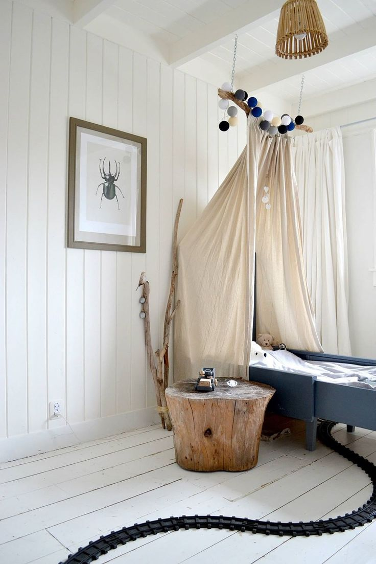 What little boy wouldn't want a train track under his wigwam style bed?! love this #kidsrooms