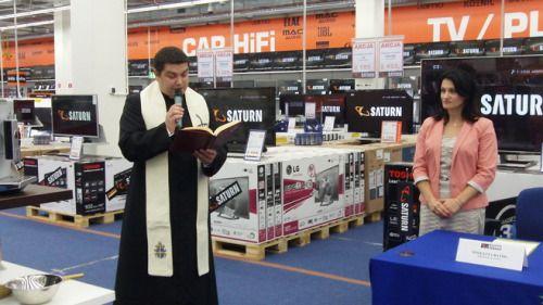 Polish priest blessing an electronics store in Łódź. 2015.